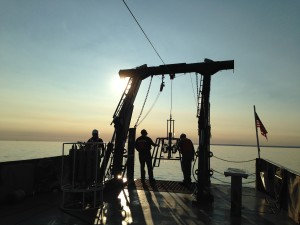 Evening operations of a sediment sampler on Lake Superior (photo by Kateri Salk)